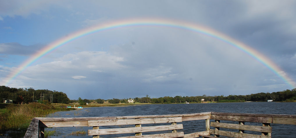 A rainbow over the lake, reminding us of God's promises