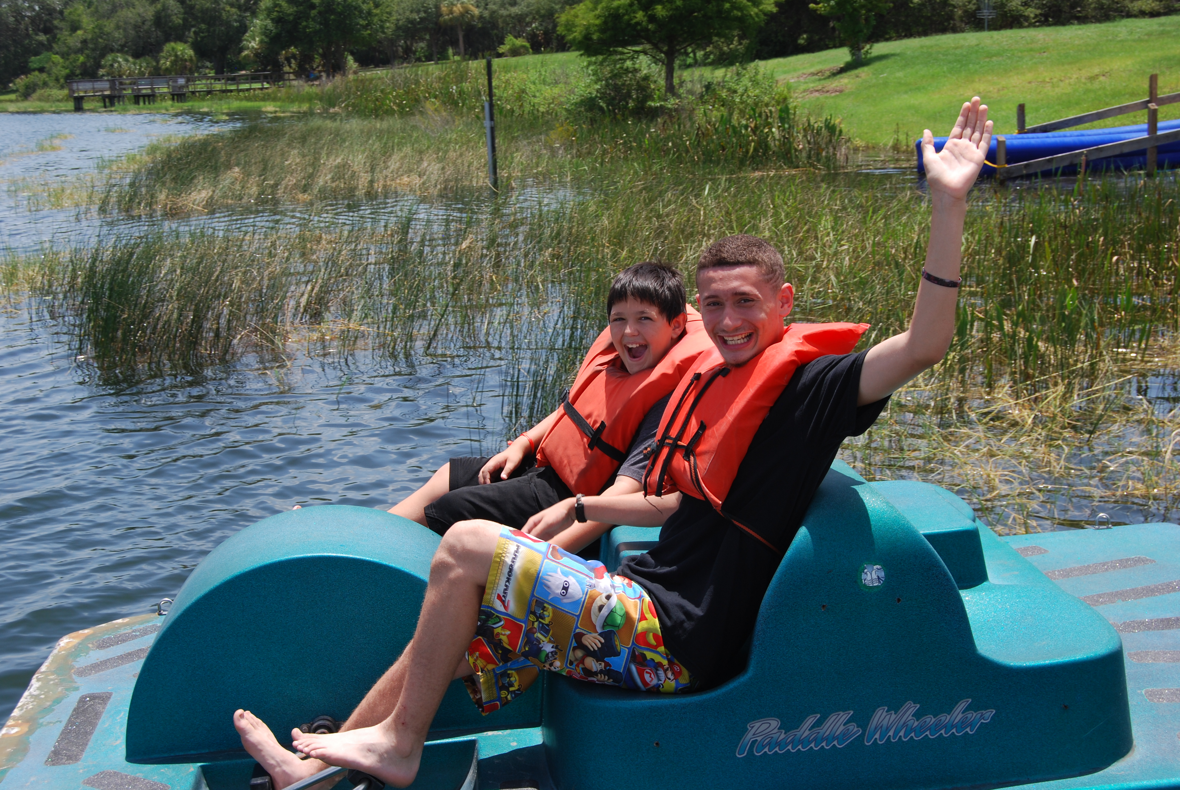Two campers enjoy a paddle boat