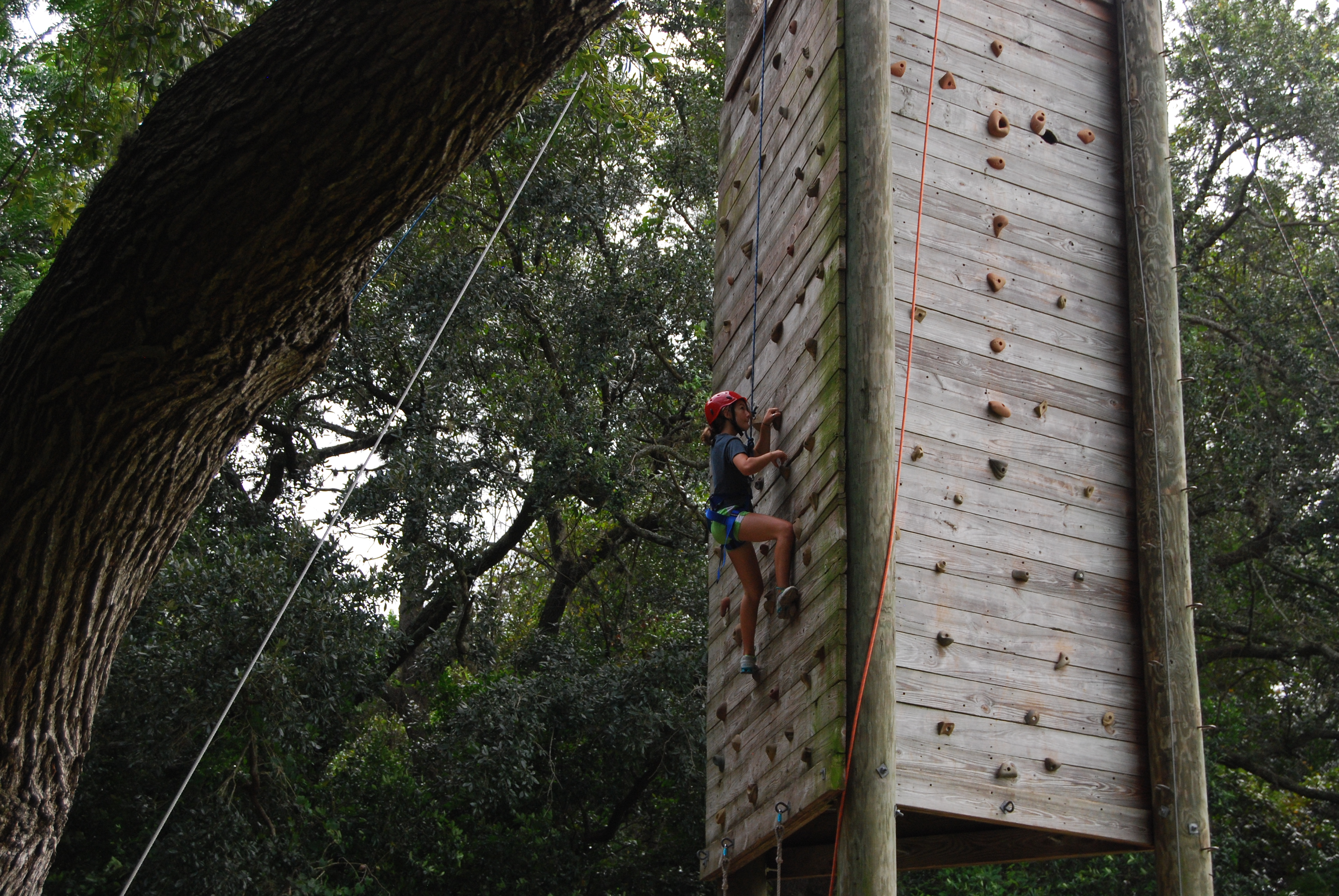 Camper climbs up climbing tower