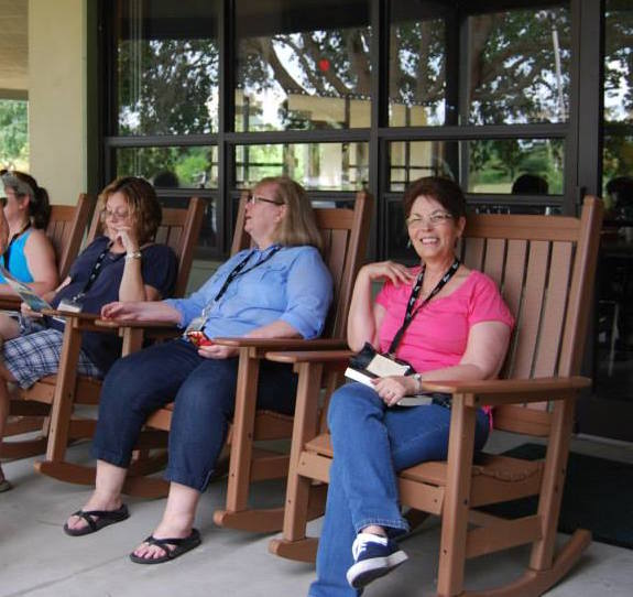Women enjoy rocking chairs at the women's retreat